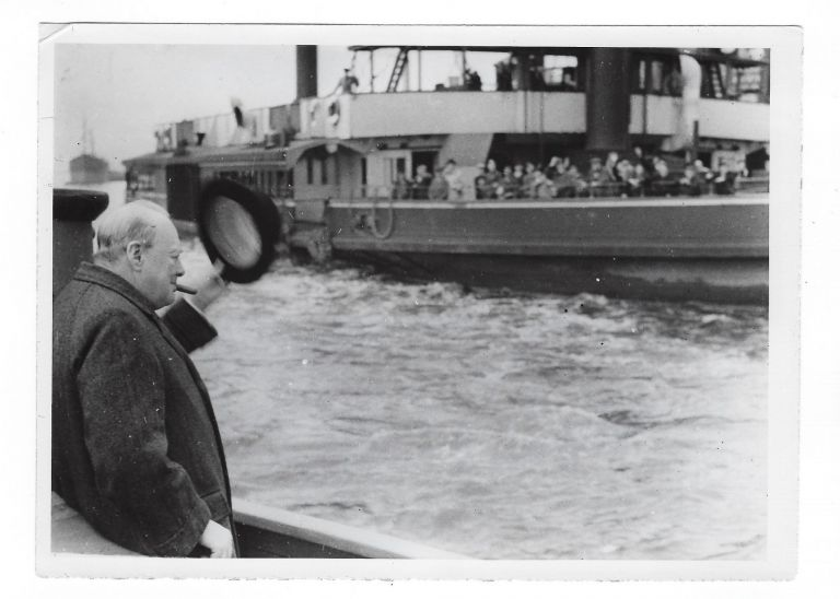 A wartime press photograph from The Associated Press German Picture Service of Prime Minister Winston S. Churchill, the German caption stating that Churchill is depicted on his way to examine the Luftwaffe damage at the London docks on 11 October 1940
