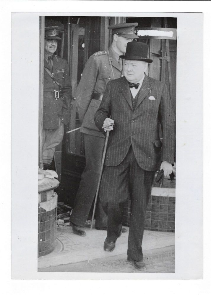A wartime press photograph from The Associated Press German Picture Service of Prime Minister Winston S. Churchill on 28 August 1940 touring Luftwaffe air raid damage in Ramsgate