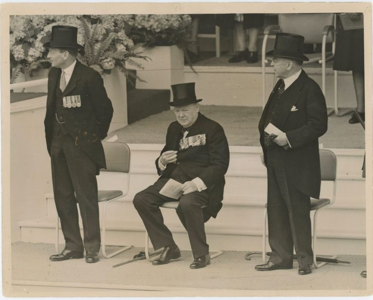PREMIERS AT THE SALUTING BASE - An original press photograph capturing British Prime Minister Clement Attlee, wartime Prime Minister Winston S. Churchill, and Canadian Prime Minister Mackenzie King at the London Victory Celebrations on 8 June 1946