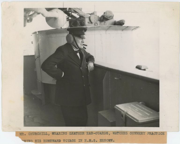 An original wartime press photograph of Prime Minister Winston S. Churchill on 16 September 1943 on board the HMS Renown for his return trip from the first Quebec Conference with President Franklin D. Roosevelt, watching gunnery practice in celebration of his daughter's twenty-first birthday