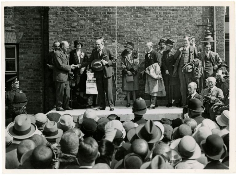 An original press photograph of Winston S. Churchill on stage for the announcement of his Parliamentary victory in Epping on 31 May 1929