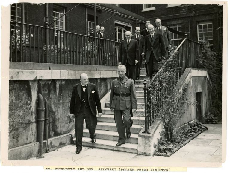 An original wartime press photograph of Prime Minister Winston S. Churchill and Polish General W adys aw Sikorski, accompanied by a number of high level British and Polish officials, in the garden of 10 Downing Street following the signing of the Anglo-Polish Agreement of 5 August 1940