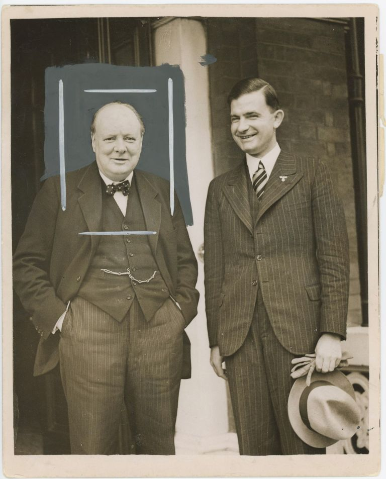 An original press photograph of the improbable spectacle of Winston S. Churchill with Ernst Bohle, the leader of the Organization of the Nazi Party Abroad, smiling together at the end of their 1 October 1937 meeting at Churchill's London residence
