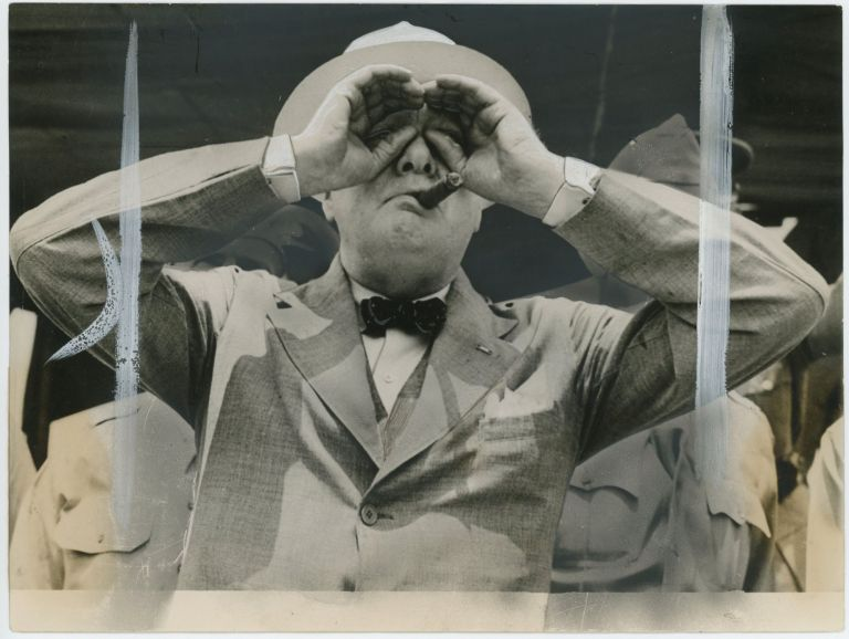 An original wartime press photograph of Prime Minister Winston S. Churchill watching American parachute troops at Fort Jackson, South Carolina on 24 June 1942