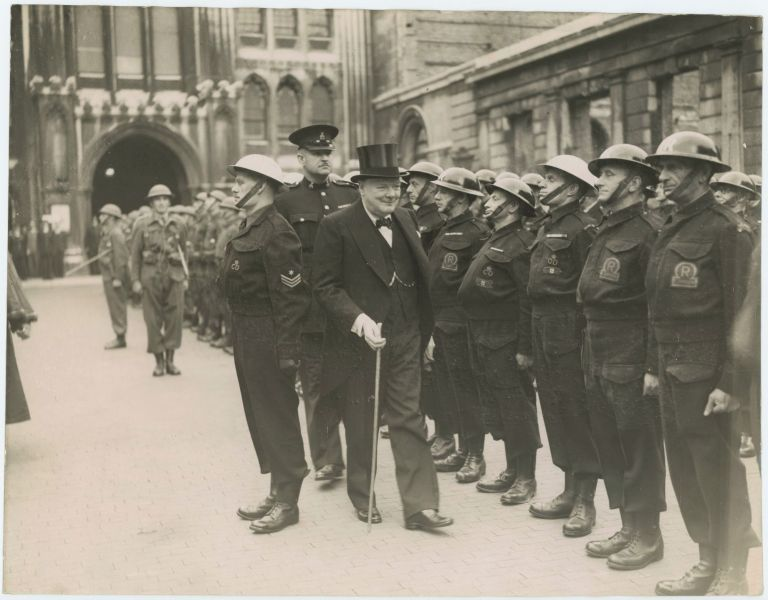 An original wartime press photograph of Prime Minister Winston S. Churchill inspecting the Home Guard in London on 30 June 1943