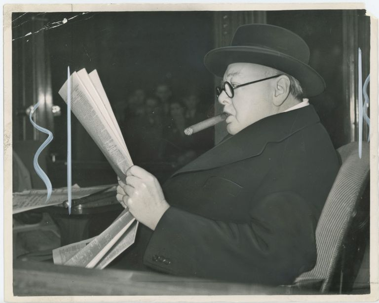 An original press photo of Winston S. Churchill on a train on 23 October 1951 after speaking in support of his son Randolph Churchill for the 1951 General Election which returned Churchill to 10 Downing Street for his second and final premiership three days after this photo was taken