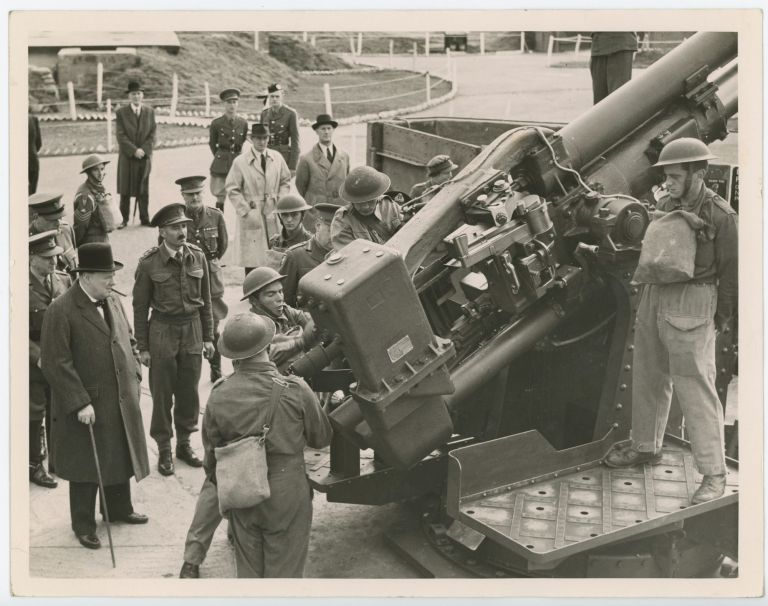 "PRIME MINISTER WITH ""ACK ACK"" GIRLS - An original wartime press photograph of Prime Minister Winston S. Churchill inspecting an anti-aircraft gun and its crew in London on 17 October 1941"