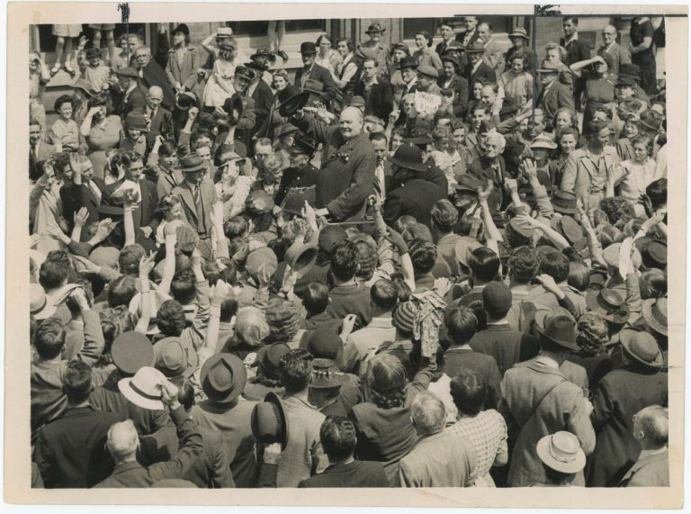 An original wartime press photograph of Prime Minister Winston S. Churchill raising his hat to a crowd during an election tour on 25 June 1945, a month before Labour's landslide General Election victory ended his wartime premiership