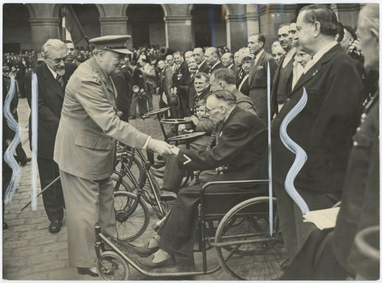 An original press photograph of Winston S. Churchill, accompanied by French Prime Minister Paul Ramadier, meeting with war-wounded veterans in Paris on 10 May 1947