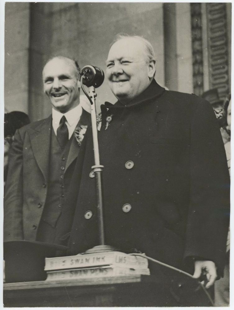 An original wartime press photograph of Prime Minister Winston S. Churchill giving a campaign speech using an improvised microphone stand during an election tour on 2 July 1945, 24 days before his Conservatives lost the General Election to Labour and Churchill relinquished his wartime premiership