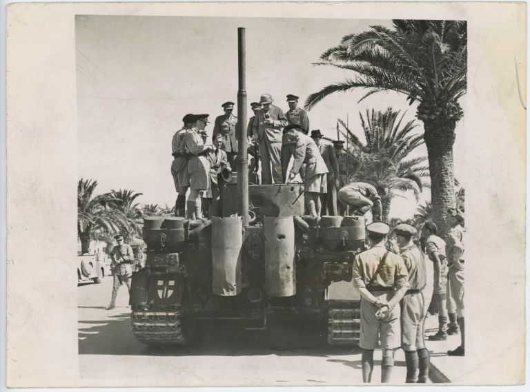 An original wartime press photograph of Prime Minister Winston S. Churchill and Foreign Secretary Anthony Eden inspecting one of the legendary German Panzerkampfwagen VI Tiger tanks in Tunis on 2 June 1943