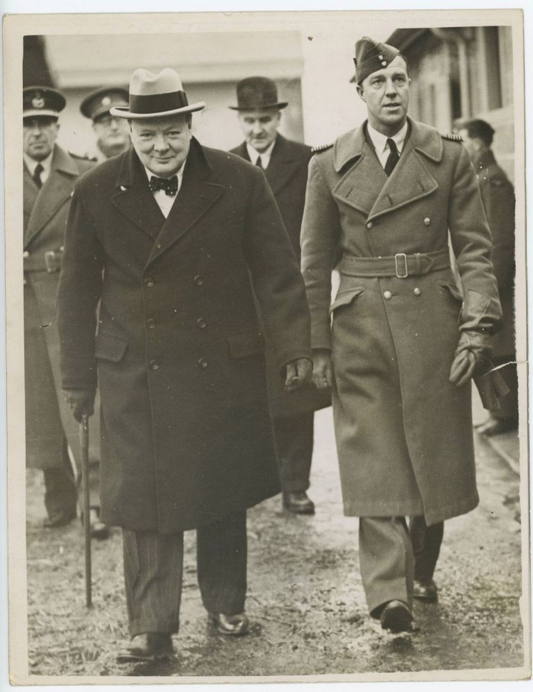 An original wartime press photograph of First Lord of the Admiralty Winston S. Churchill touring the RAF Headquarters in France on 7 January 1940, less than half a year before Churchill's ascension to the premiership, the Dunkirk evacuation, and the fall of France