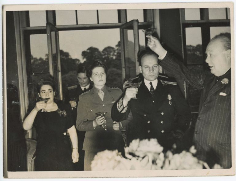 An original wartime press photograph of Prime Minister Winston S. Churchill and his daughter Mary making a toast at the Soviet Embassy on 9 May 1945, the day after VE Day
