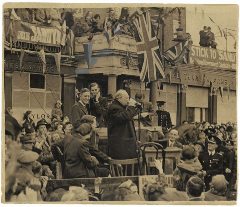 The Man with a Pint of Beer is Mr. Churchill – an original press photograph of wartime Prime Minister Winston S. Churchill on 4 July 1945 drinking a pint of beer on stage during an appearance in support of his son-in-law's campaign for the 1945 General Election
