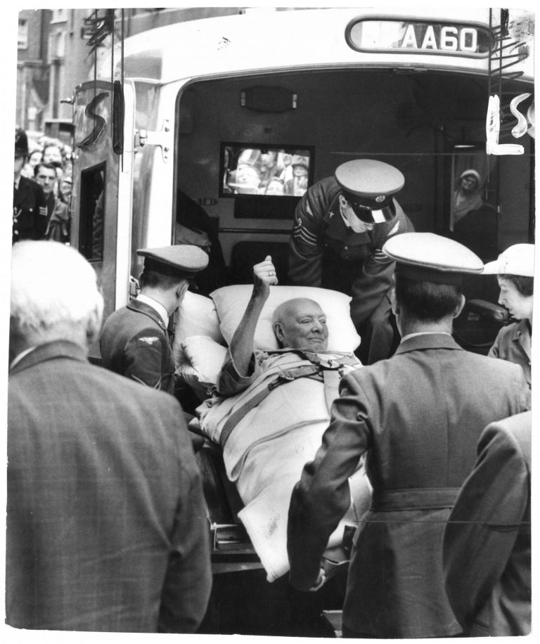 An original press photo of Sir Winston S. Churchill being lifted out of the ambulance at Middlesex Hospital on 29 June 1962, following his fall in Monte Carlo and dramatic return to England via R.A.F. Comet jet on the orders of Prime Minister Harold Macmillan