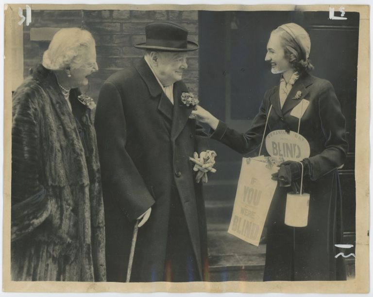 An original press photo of Winston S. Churchill and Lady Clementine Churchill purchasing a geranium for the Greater London Fund for the Blind on 9 April 1957