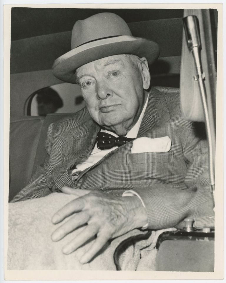 An original press photo of Sir Winston S. Churchill after arrival at London Airport on 4 September 1961, having returned home from a holiday in the south of France