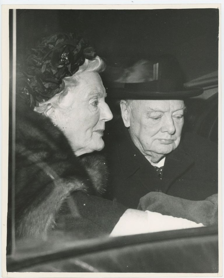 An original press photo of Sir Winston S. Churchill and Lady Clementine Churchill showing them in their car en route from London Airport to their Hyde Park Gate home having just returned from holiday in the south of France