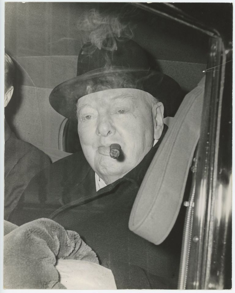 An original press photo of Sir Winston S. Churchill on 4 April 1960 smoking a cigar on his way to the House of Commons to listen to the Chancellor of the Exchequer's Budget speech