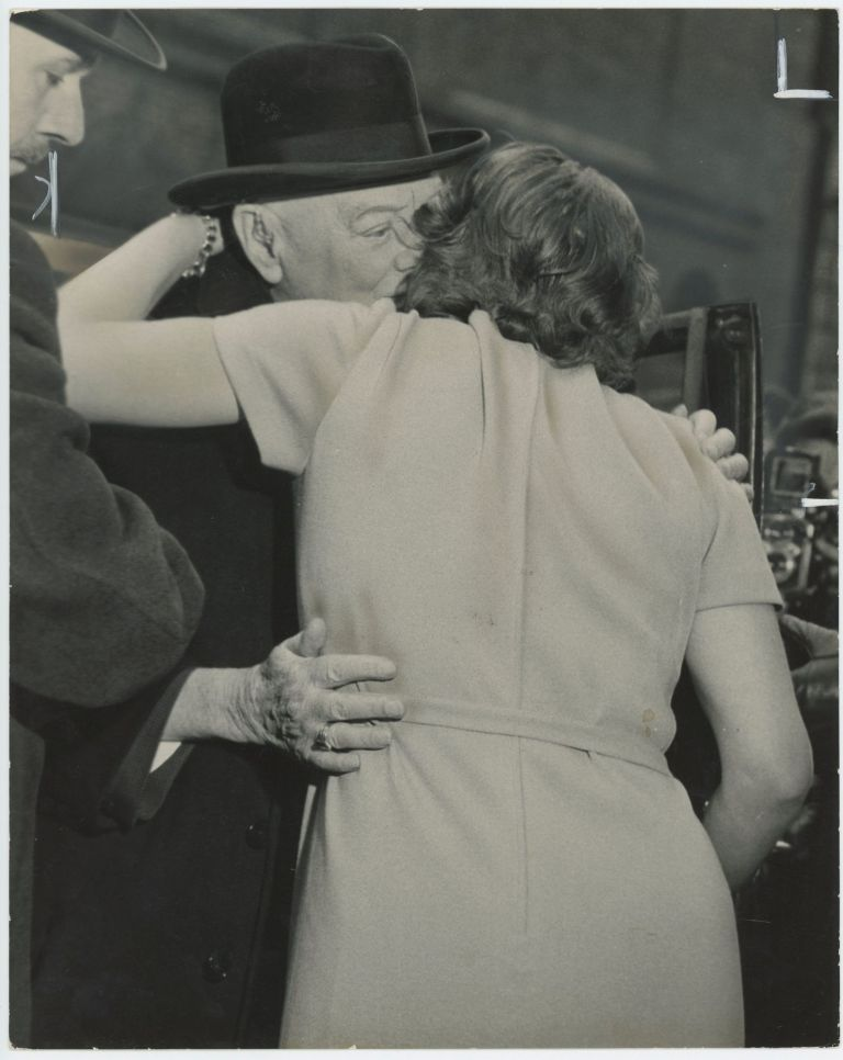 An original press photo of Sir Winston S. Churchill greeting and hugging his daughter, Mary, on 1 April 1963 - her mother, Lady Clementine Churchill's, 78th birthday