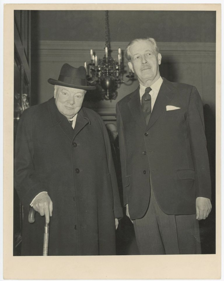An original press photo of Sir Winston S. Churchill and Prime Minister Harold Macmillan at Admiralty House on 8 February 1961