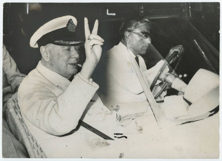 An original press photograph of Sir Winston S. Churchill flashing his famous V sign while being driven through Istanbul by Aristotle Onassis on 10 August 1959 - a deliciously ironic and improbable convergence of history and symbols