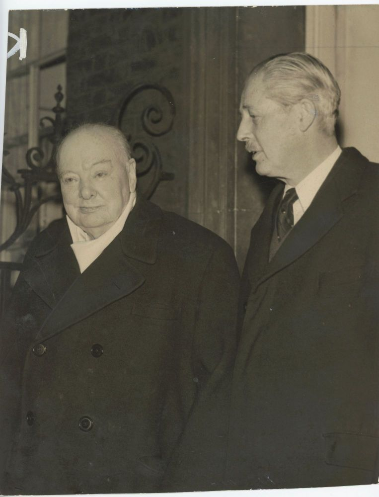 An original press photo of Sir Winston S. Churchill with Prime Minister Harold Macmillan at 10 Downing Street on 13 December 1957