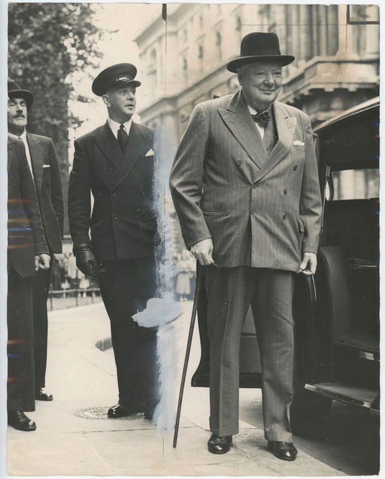An original press photo of Sir Winston S. Churchill arriving at 10 Downing Street on 29 July 1955 to lunch with his successor, Prime Minister Anthony Eden, just a few months after Churchill's resignation and only days after Eden's summit with the U.S., Soviet, and French leaders