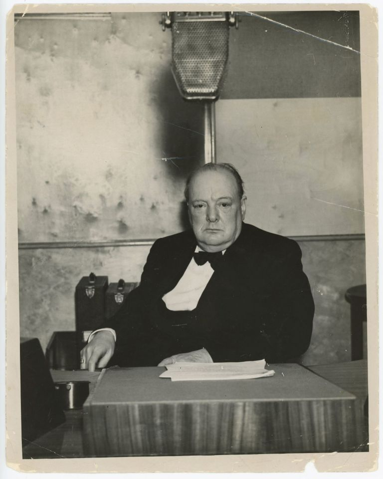 WINSTON CHURCHILL BROADCASTS TO NATION - An original press photo of First Lord of the Admiralty Winston S. Churchill delivering his first wartime broadcast on 1 October 1939