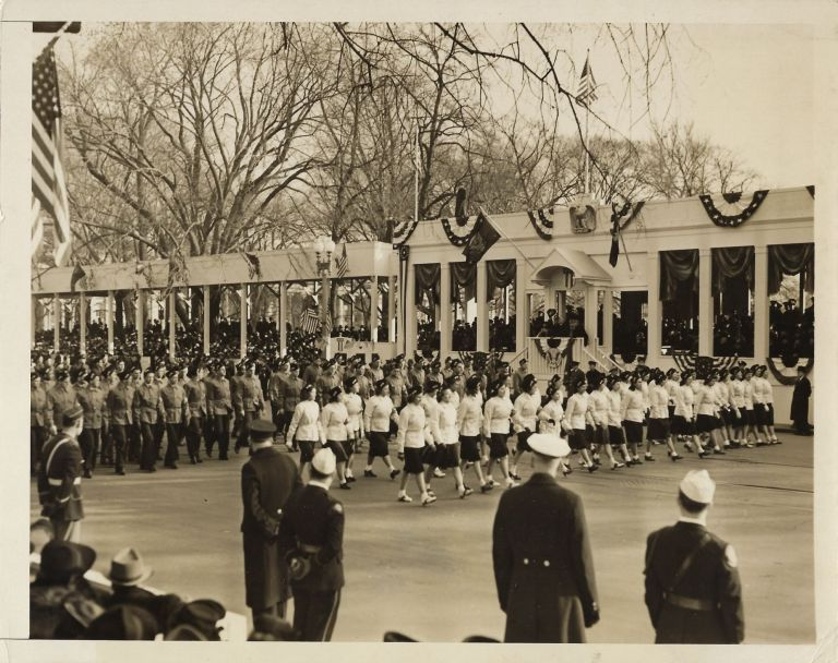 An original press photo of the 20 January 1941 Inaugural Parade for Franklin Delano Roosevelt's unprecedented and unrepeated third presidential term, youth of his National Youth Administration passing in review as the President waves his hat