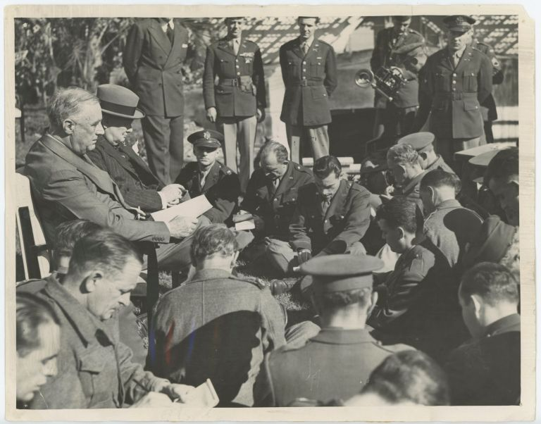 An original wartime press photograph of Prime Minister Winston S. Churchill and President Franklin D. Roosevelt meeting with British and American war correspondents at the Casablanca Conference on 24 January 1943