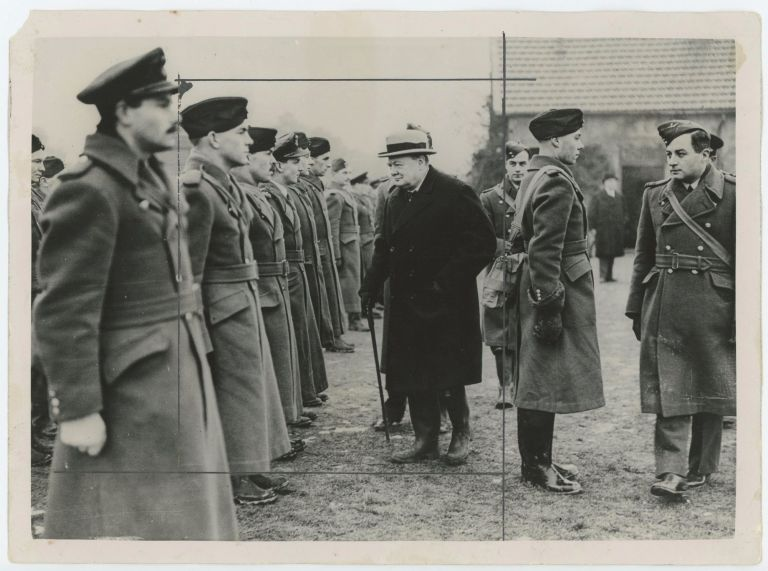 "An original wartime press photograph of First Lord of the Admiralty Winston S. Churchill inspecting a ""guard of honour of R.A.F. airmen"" in France on 7 January 1940, less than half a year before Churchill's ascension to the premiership, the Dunkirk evacuation, and the fall of France"