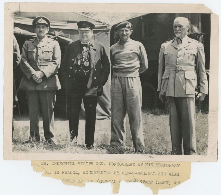 An original wartime press photograph of Prime Minister Winston S. Churchill, Field Marshal Sir Alan Brooke, and General Smuts with General Bernard Montgomery at his Headquarters in Normandy on 12 June 1944, less than a week after the D-Day landings
