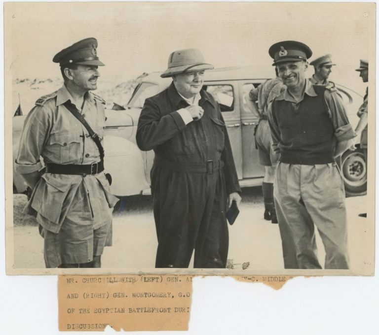 An original wartime press photograph of Prime Minister Winston S. Churchill, General Harold Alexander, and General Bernard Montgomery, the two commanders he had just promoted, at Montgomery's desert headquarters in Egypt on 19 August 1942