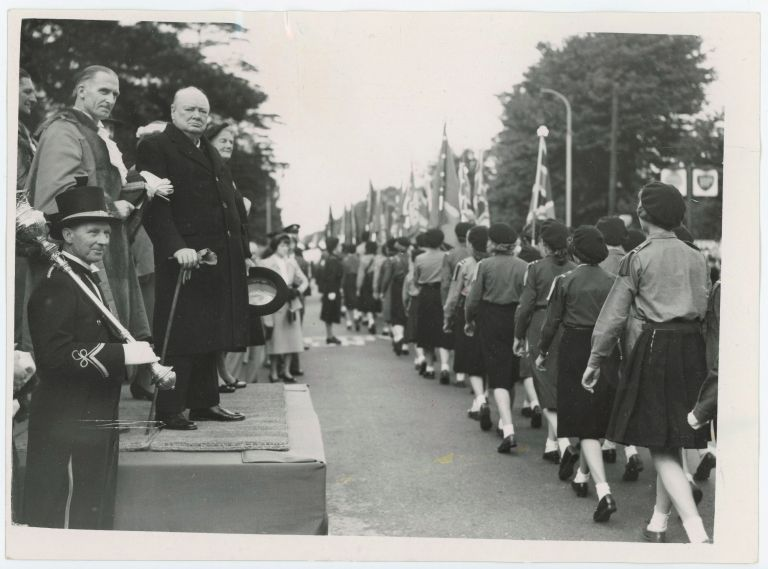 An original press photograph of Prime Minister Winston S. Churchill and his wife, Clementine, attending the Coronation parade for Queen Elizabeth II in Churchill's Woodford constituency on 31 May 1953