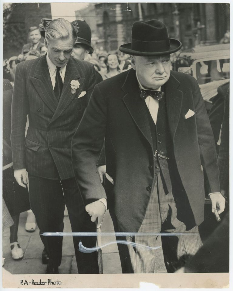 GRAVE FACES IN DOWNING STREET - an original press photograph of Winston S. Churchill and Anthony Eden on 16 August 1950 arriving at 10 Downing Street to meet with Prime Minister Clement Attlee