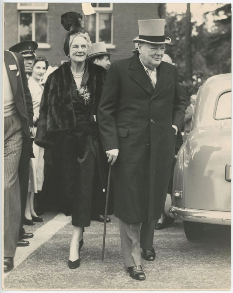 An original press photograph of Winston S. Churchill and his wife, Clementine, arriving at Ascot on 15 June 1950 where Churchill's horse, Colonist II, was running in the Ascot Gold Cup