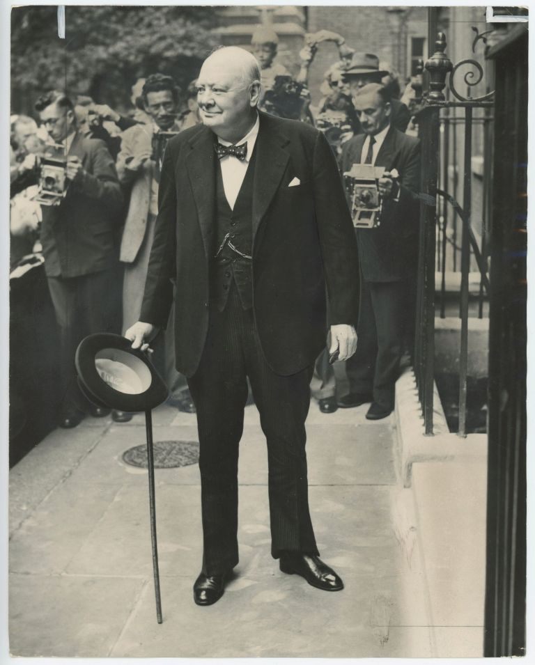 An original press photo of Prime Minister Sir Winston S. Churchill in front of a battery of photographers at 10 Downing Street on 27 August 1954