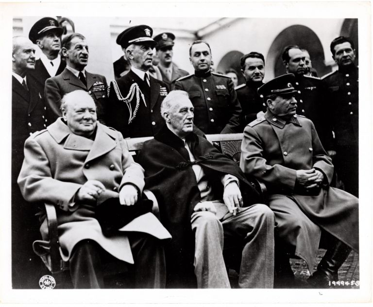 A Second World War U.S. Army Signal Corps photograph featuring British Prime Minister Winston S. Churchill, U.S. President Franklin D. Roosevelt, and Soviet Premier Josef Stalin at the Yalta Conference in February 1945, the final meeting of these three leaders. Yevgeny Khaldei.