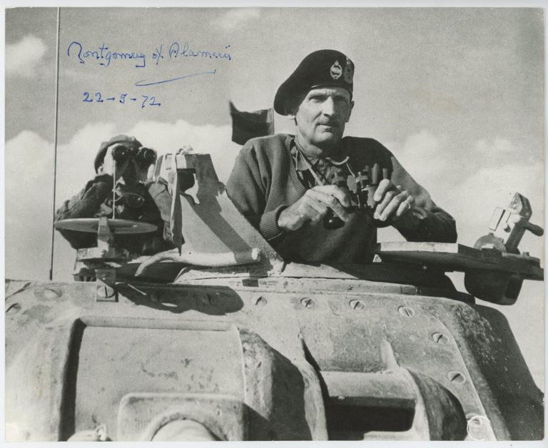 """MONTY IN THE WESTERN DESERT"" - a 5 November 1942 Second World War image of then-General Bernard Law Montgomery in the turret of his Grant command tank at El Alamein, originally captured by a member of the Army's Film & Photographic Unit and signed and dated by Montgomery on 22 May 1972. Image, No. 1 Army Film Major Geoffrey Keating, Photographic Unit."
