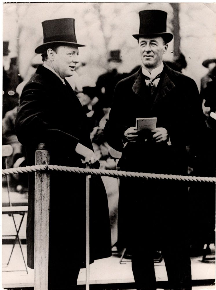 An original press photograph of then-First Lord of the Admiralty Winston Churchill and his friend and fellow Cabinet member, then-Secretary of State for War Jack Seely, watching the Review of the Brigade Guard in Hyde Park in 1913, on the verge of the First World War which would see them become the only two Cabinet members to also serve on the Front