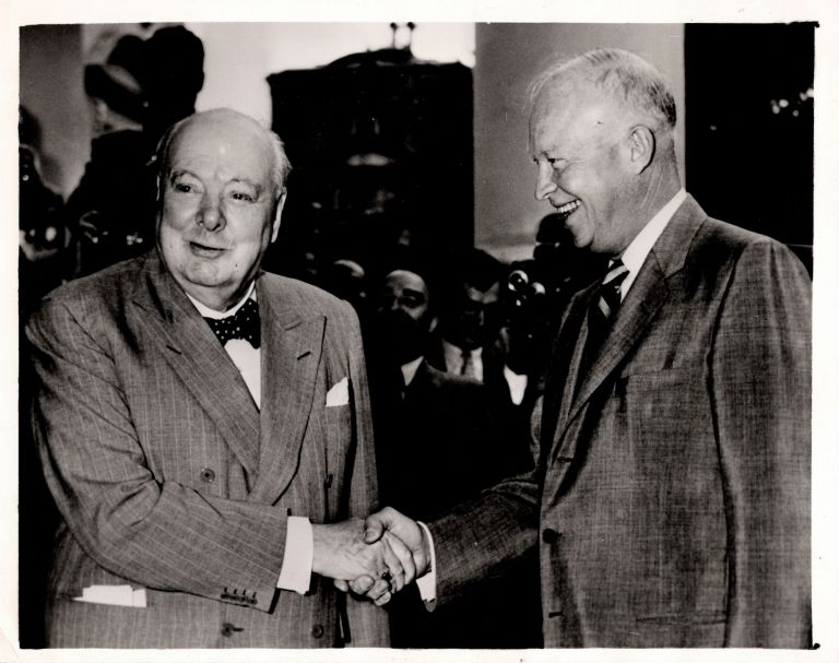 An original press photograph of Prime Minister Sir Winston S. Churchill bidding farewell to President Eisenhower at the White House on 29 June 1954, at the end of Churchill's final Washington visit as British premier