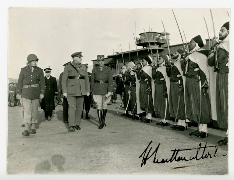 An original Second World War photograph of British General Henry Maitland Wilson inspecting French Foreign Legion troops, signed by Maitland Wilson