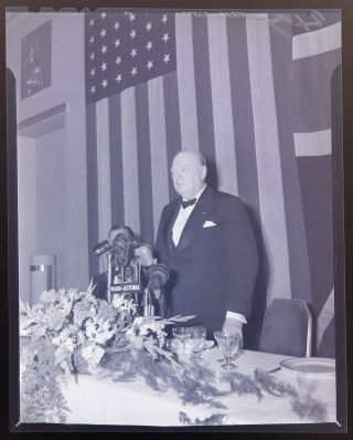 "Three original photographic negatives of Winston S. Churchill with Thomas E. Dewey delivering a speech at the Waldorf Astoria Hotel in New York on 15 March 1946, staunchly defending his controversial ""Iron Curtain"" speech delivered ten days prior in Fulton, Missouri"