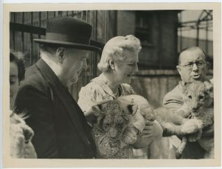 An original wartime press photograph of Prime Minister Winston S. Churchill and Clementine...