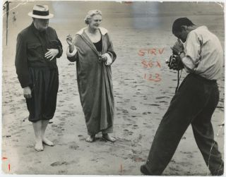 An original press photograph of Winston S. Churchill and Clementine Churchill on the beach at...