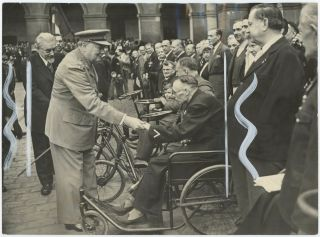 An original press photograph of Winston S. Churchill, accompanied by French Prime Minister Paul...