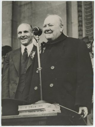 An original wartime press photograph of Prime Minister Winston S. Churchill giving a campaign...