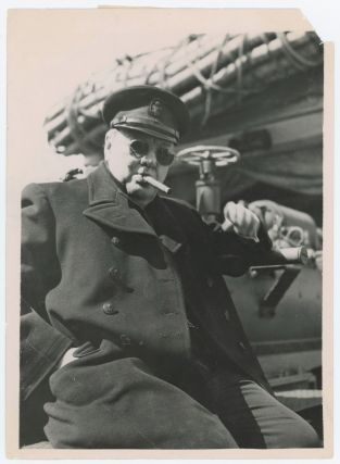 An original wartime press photograph of Prime Minister Winston S. Churchill on board the...