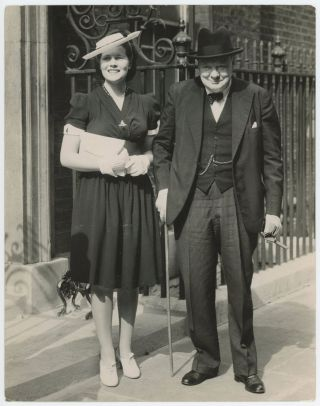 An original wartime press photograph of Prime Minister Winston S. Churchill and his daughter,...